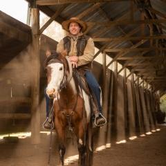 horse-rider-barn-rural-photo